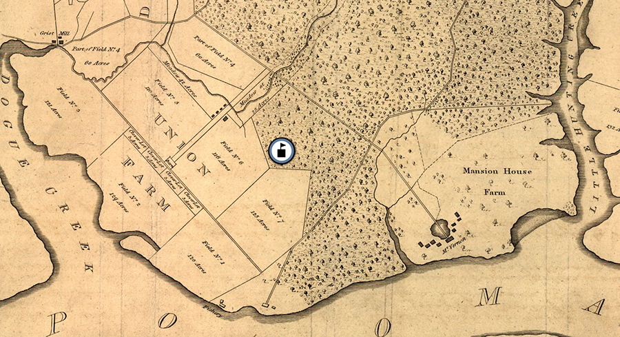 The image shows a portion of George Washington's map of Mount Vernon. The entire estate was approximately 8,000 acres in size and was comprised of five separate farms. Two of these farms, Mansion House Farm and Union Farm, are visible in this image. The map was drawn with iron gall ink on paper or parchment. The ink has faded to a light brown / gray color and the paper has faded to a light tan. An icon of a schoolhouse has been placed on the map, showing Washington Mill Elementary School was located on forested land adjacent to Union Farm.