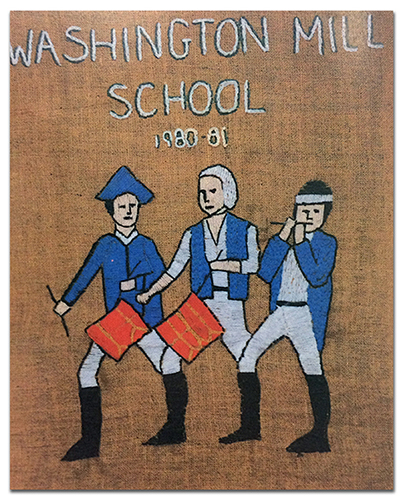Color photograph of the Colonials mascot printed in our 1997 to 1998 yearbook. It appears to be a needlepoint embroidery on canvas. Embroidered text reads: Washington Mill School, 1980 to 81, Mr. Ringman, 5th Grade. The mascot is three men wearing blue and white American Revolutionary War era uniforms with black boots. Two of the men are beating red drums and a third is playing a flute. One of the men is wearing a blue tri-cornered hat. These colorful figures have been stitched onto a brown canvas backing.